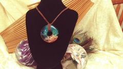 Turquoise and Light Pink Resin pendant on Suede Cord