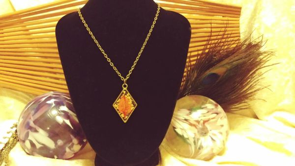 Orange Leaf on Yellow Burst Antique Diamond Resin Pendant