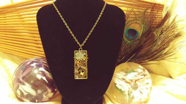 Silver Rose(ul), Brass Key(cntr), Yellow Butterfly, 2 Back Cogs, Tall Resin Pendant