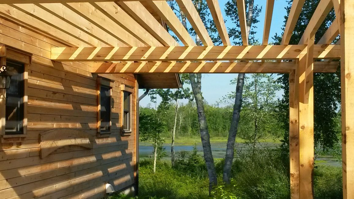White Pine Milled Log House and Attached Pergola from Minnesota Timber and Millwork