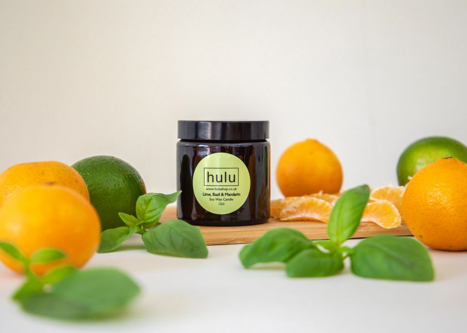 A soy candle with limes and mandarins.