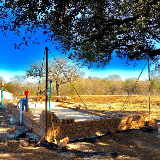 Walls going up on a compressed earth block home