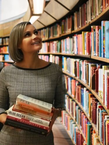 Women with books in library. Professional books. smile. library. books