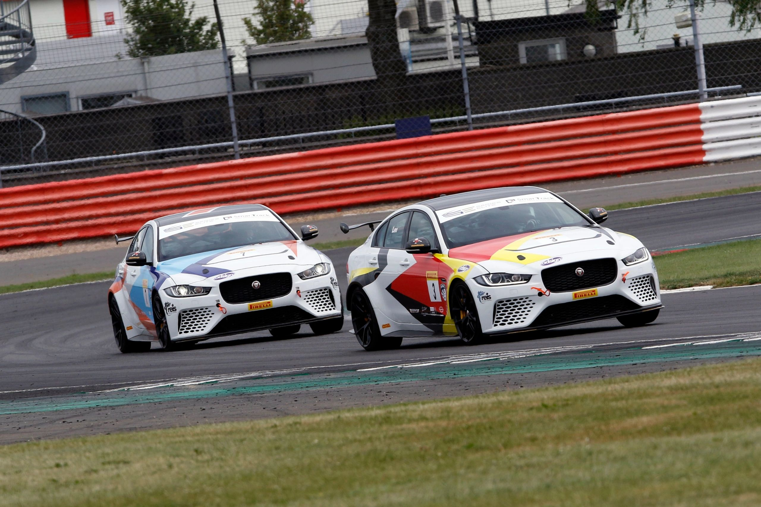 Two Series Elite Jaguar Project 8 race cars on track racing in team livery