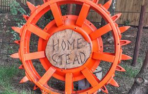 Rustic agricultural tractor wheels enhance the entrance. hello@yorkshirehomestead.com