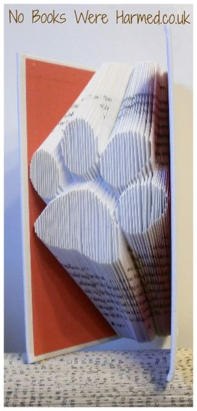 Single paw print : : Hand folded, designer made, non cut book art