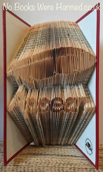 Feathers appear... : : hand folded book art