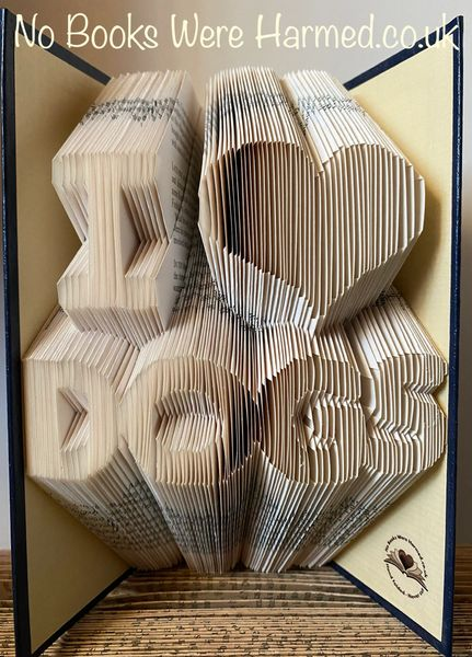 """I ♥ DOGS"" Hand folded, non cut book art sculpture"