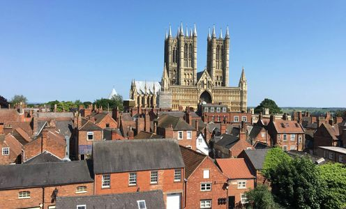 A view from Lincoln Castle across rooftops towards Lincoln Cathedral