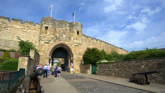 Lincoln Castle in summer with people outside queueing to enter