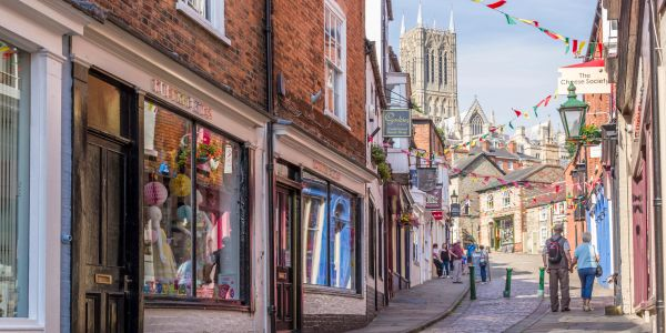 The Strait in Lincoln with colourful shop fronts and the Cathedral in the background