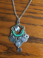 "Silver with green beads on a 30"" chain"
