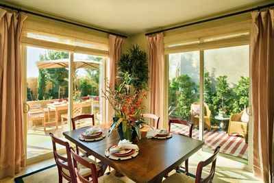 Two Monte Verde sliding patio doors in a kitchen breakfast nook.