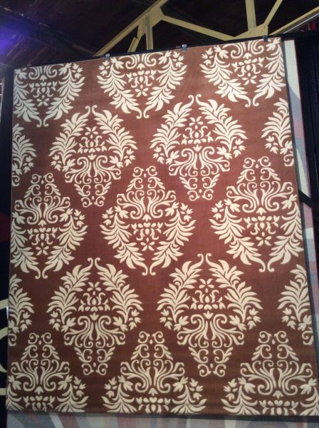 Creme and brown 8x10 machine made rug