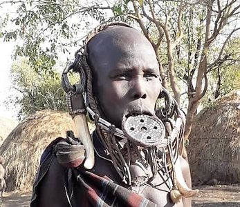 Mursi woman with lip plate in Mago National park Omo Valley Ethiopia