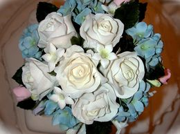 Handmade sugar roses, hydrangeas and stephanotis bouquet floral keepsake wedding cake topper.