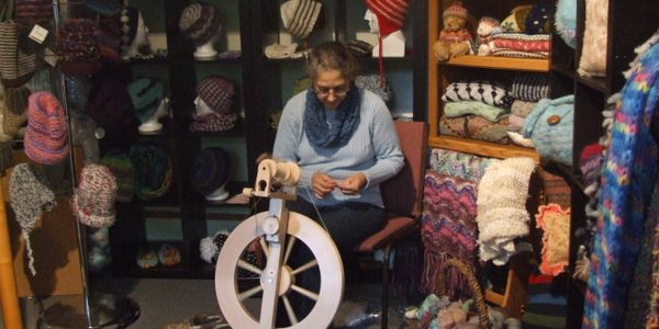 Marty spinning surrounded by what she has made