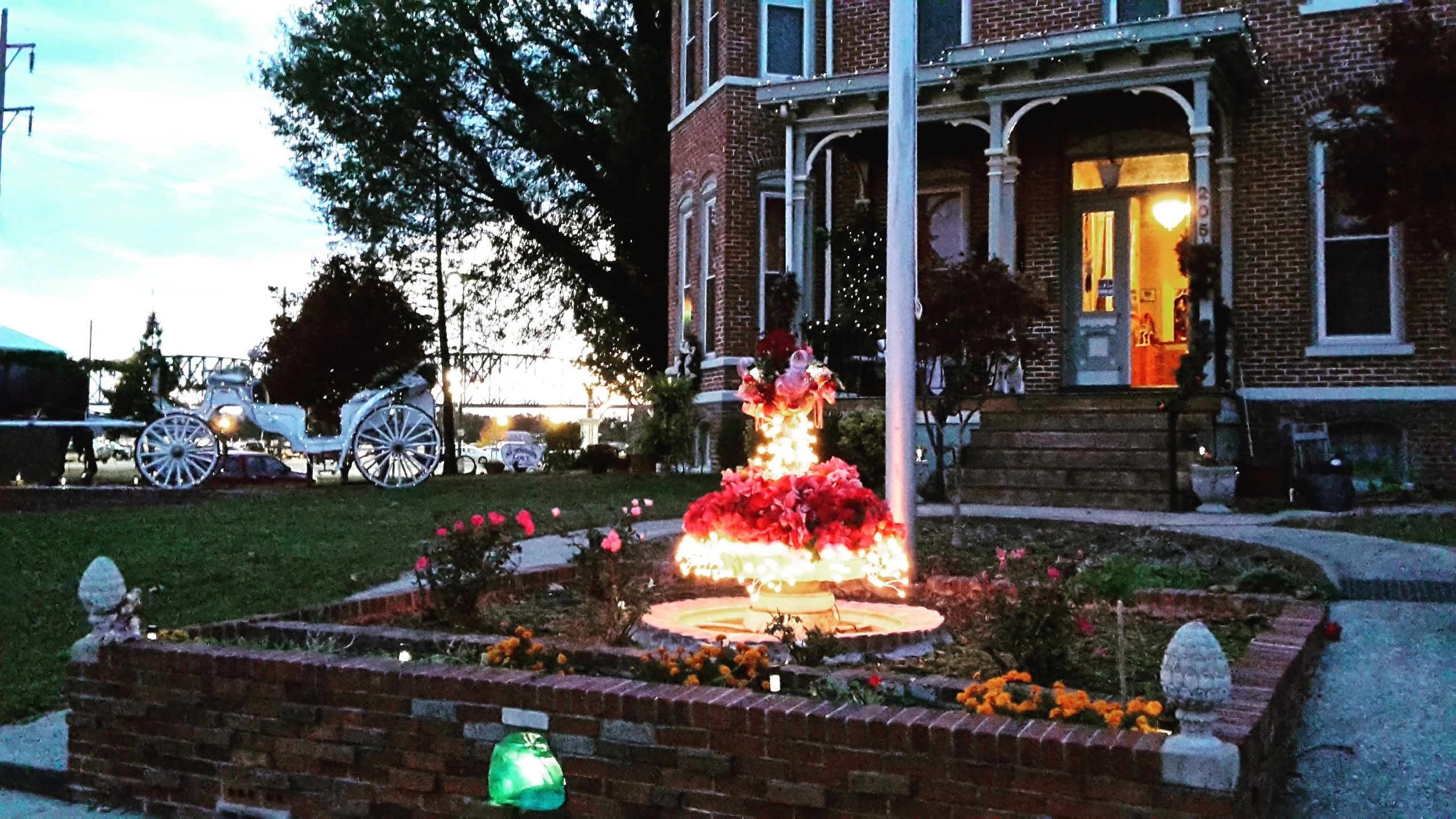 Front fountain with 3 layers of lights and poinsettias.