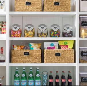 Organized pantry with labeled containers and baskets