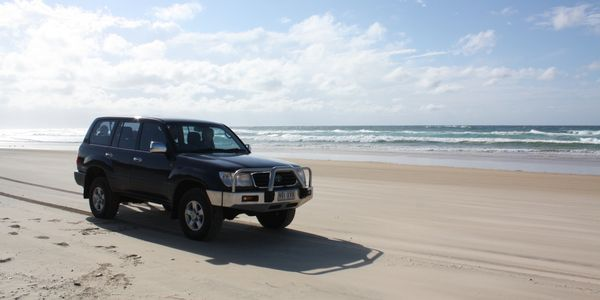 4WD vehicle to transfer walkers around the Fraser Island Great Walk.