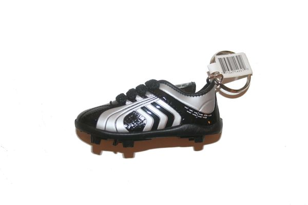 BLACK WHITE SHOE CLEAT KEYCHAIN .. NEW AND IN A PACKAGE