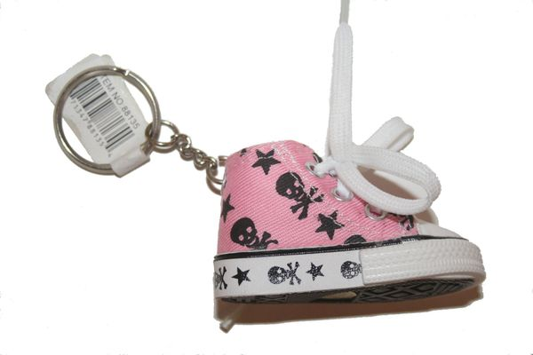 SKULL WITH BONES PINK SHOE CLEAT KEYCHAIN .. NEW AND IN A PACKAGE