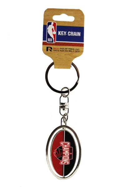 "TORONTO RAPTORS 2019 NBA CHAMPIONS Oval Shape SPIN Metal KEYCHAIN Size : 2.5"" X 1.3"" Inch.RICO INDUSTRIES INC.Great Quality New …"