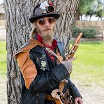 Man in Custom Steampunk Hat, Gun, Jacket, Goggles, Belt, Pouches, and More!!