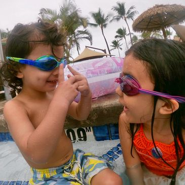 brother and sister in swimming pool learn to swim in kaanapali maui
