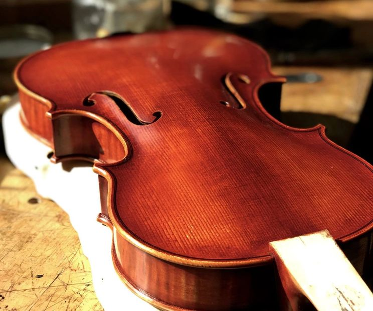 Crafting a violin by John Hill