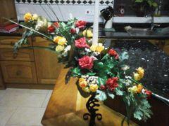 FLOWER ARRANGEMENT ON A CANDLE HOLDER
