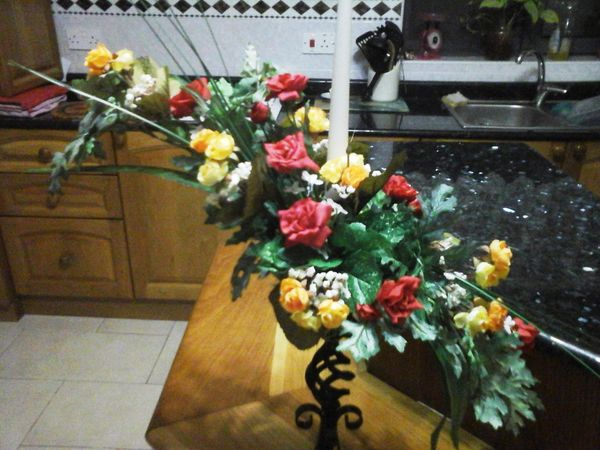 FLOWER ARRANGEMENT ON A CANDLE HOLDER