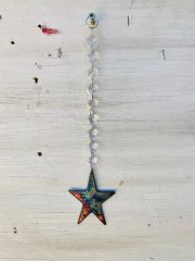 Hanging-Star hangs from crystal strand