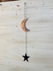 Hanging-Moon and star hangs from a crystal strand