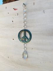 Hanging-Peace sign hangs from crystal strand and embellished with crystal teardrop