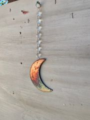 Hanging-Moon hangs from crystal strand