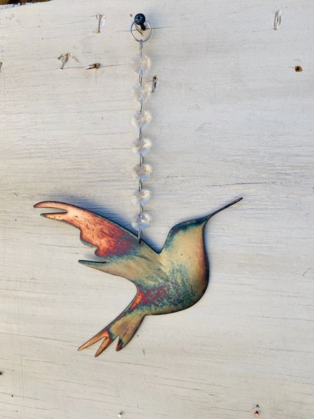 Hanging-Hummingbird hangs from a crystal strand