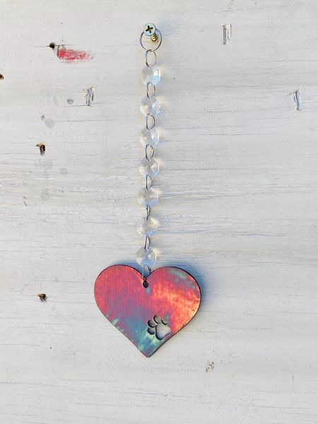 Hanging-Heart with paw print hangs from crystal strand