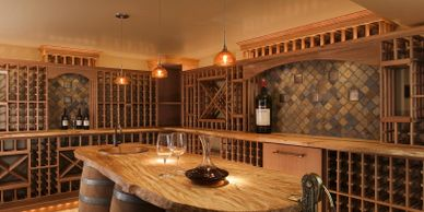 Traditional wood wine cellar with stone display arches and a center table held up by large barrels.