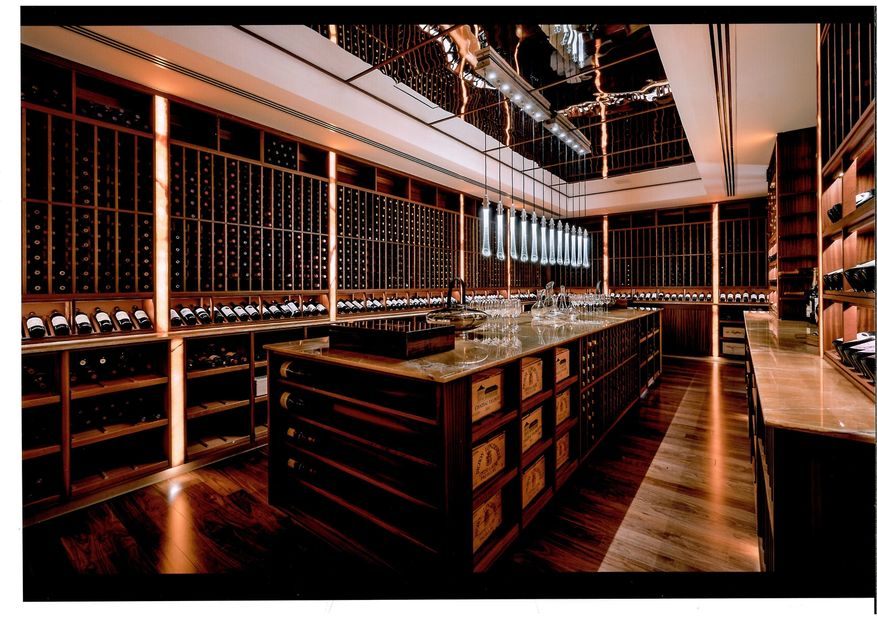 Custom wine cellar made with sapele wood and onyx countertops.