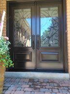 chocolate brown double entry doors with wrought iron and executive panels