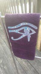 Plum Left Eye of Heru Hand Towel with Powder Blue Batik