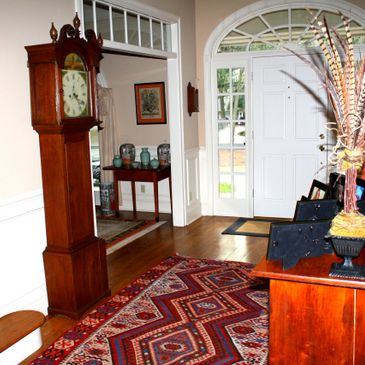 exploring different eras, and adding different cultures invites comfort and interest, 1800's grandfather clock, along with handmade area rug