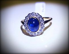 9YG Sapphire and Diamond Cluster Ring.