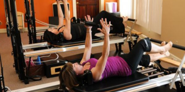 New student intro packages Stott Pilates in Upland at Om Sweet Om Pilates Center