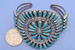 Dead-pawn Zuni Pueblo-style Sterling pedi-point cuff by Tommy Lowe.