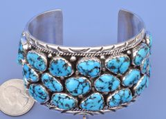 Very traditional Navajo cluster cuff with 29 Sleeping Beauty mine turquoise stones.