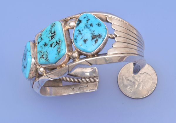 Dead-pawn Sterling silver Thick-gauge Sterling silver Navajo cuff with three Sleeping Beauty turquoise stones.