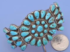 Older dead-pawn Zuni pedi-point cluster cuff with Sleeping Beauty turquoise.