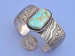 Larger Navajo dead-pawn Sterling cuff with Royston, Nevada turquoise by Lionel Dabbs.—SOLD!